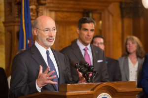 Gov. Tom Wolf with Jay Wright speaking at the capitol. Credit: State of PA